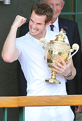 Andy Murray celebrates from the balcony of the All England Club after winning the Men's Final at the Wimbledon Tennis Championships in  London, Sunday, 7th July 2013<br /> Picture by Stephen Lock / i-Images