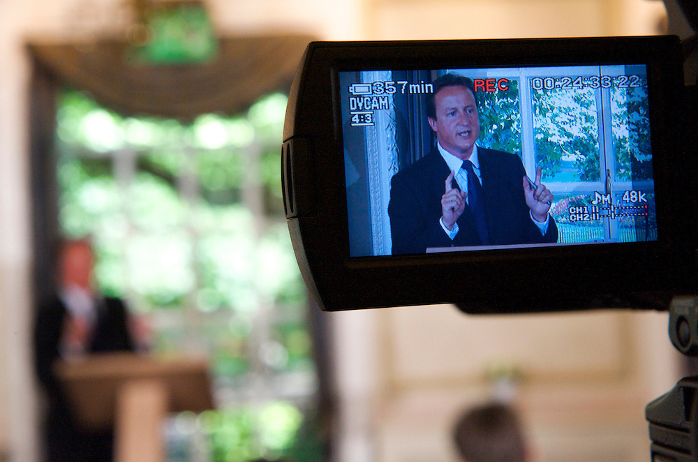 """LONDON, August 12, 2008.  A video camera viewfinder displays Conservative leader David Cameron delivering his monthly press conferences at St. Stephen's Club.  He specifically addressed the war in Georgia, condemning Russia stating """"it is unacceptable to invade another country.""""  .."""