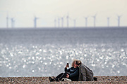 A couple is seen taking a selfie and sharing a kiss as they enjoy the sunny weather along the Brighton Beach on Sunday, April 11, 2021.  On Monday, April 12, England enters the next stage of government's roadmap out of lockdown, when the non-essential shops, outdoor hospitality, and personal services including hairdressing can open again. (Photo/ Vudi Xhymshiti)