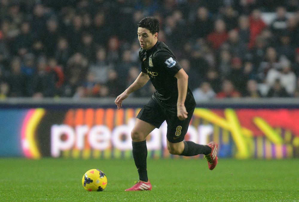 Manchester City's Samir Nasri in action during todays match  <br /> <br /> Photo by Ian Cook/CameraSport<br /> <br /> Football - Barclays Premiership - Swansea City v Manchester City - Wednesday 1st January 2014 - Liberty Stadium - Swansea<br /> <br /> © CameraSport - 43 Linden Ave. Countesthorpe. Leicester. England. LE8 5PG - Tel: +44 (0) 116 277 4147 - admin@camerasport.com - www.camerasport.com