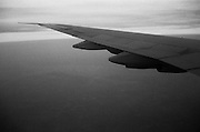 Moody view of 747 airplane wing out the window - 1988..One of my first solo flights to Europe when I first caught the travel bug - JFK or LHR
