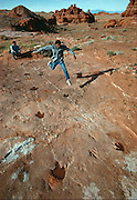 At a dinosaur trackway site near Cameron, Arizona, native American Jason Stevens tries unsuccessfully to match the stride of an ancient predator which was as fast as an Olympian athlete's.