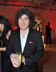 Advertising figure TREVOR BEATTIE at a dinner in aid The Journalism Foundation held at Philips De Pury & Company, Howick Place, London, SW1 on 22nd May 2012.