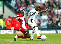 Photo: Chris Ratcliffe.<br /> Middlesbrough v West Ham United. The FA Cup, Semi-Final. 23/04/2006.<br /> Nigel Reo-Coker of West Ham clashes with George Boateng of Middlesbrough