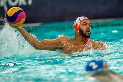 Bilal Gbadamassi of the Netherlands in action against Romania during the Olympic qualifying tournament. The Dutch water polo players are on the hunt for a starting ticket for the Olympic Games on February 16, 2021 in Rotterdam