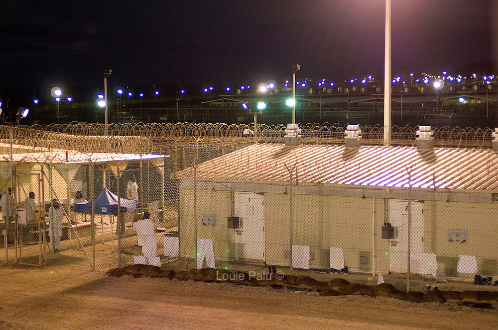 """Detainees seen outside their cells in Camp 4 at the detention facility in Guantanamo Bay, Cuba. Camp 4 is a communal style camp where more compliant detainees live in small groups and have access to a more open air environment. Approximately 250 """"unlawful enemy combatants"""" captured since the September 11, attacks on the United States continue to be held at the detention facility.(Image reviewed by military official prior to transmission)"""