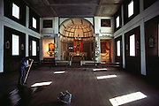A worker mops the wooden floor of the main chapel at the Cataldo Mission, Cataldo, Idaho, USA.
