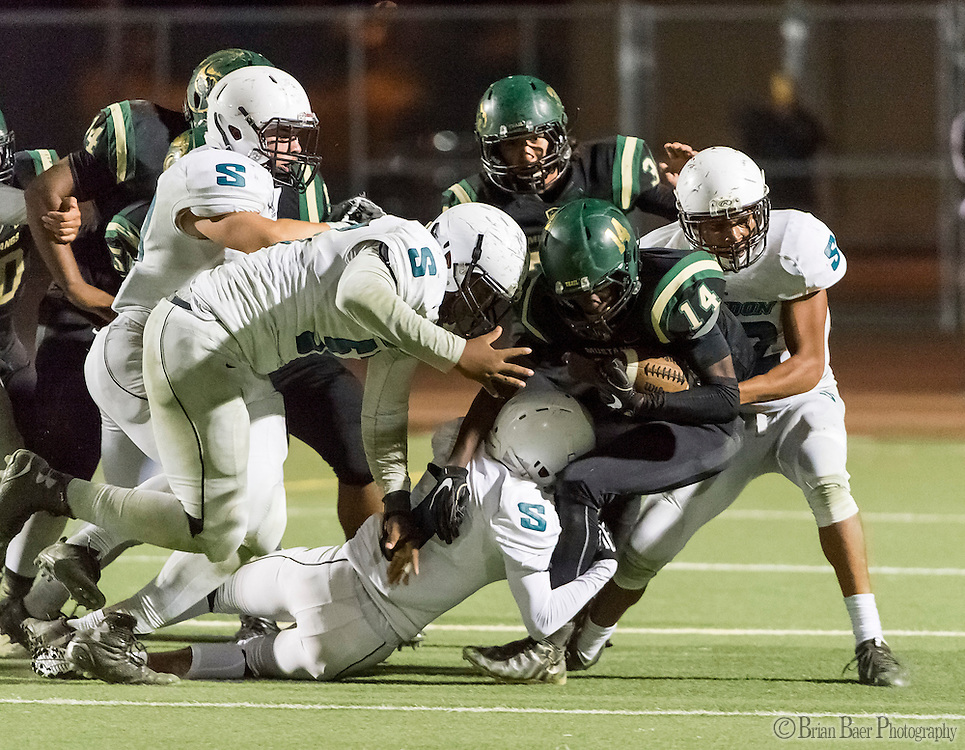 Monterey Trail Mustangs Jehiel Budgett (14), runs with the ball during the third quarter as the Monterey Trail Mustangs host the Sheldon High School Huskies Friday Sep 23, 2016. Sheldon won the game 27-22.<br /> photo by Brian Baer