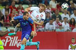 01-06-2016 POL: Polen - Nederland, Gdansk<br /> Oefenwedstrijd dat met 2-1 wordt gewonnen / Kamil Glik (POL), Bas Dost (NED) <br /> <br /> ***NETHERLANDS ONLY***
