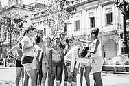 Cuban school girls prepare to do the physical education portion of their day on the Prado (Paseo de Marti) in Havana, Cuba. (December 4, 2014)