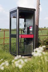 Telephone box in rural setting,