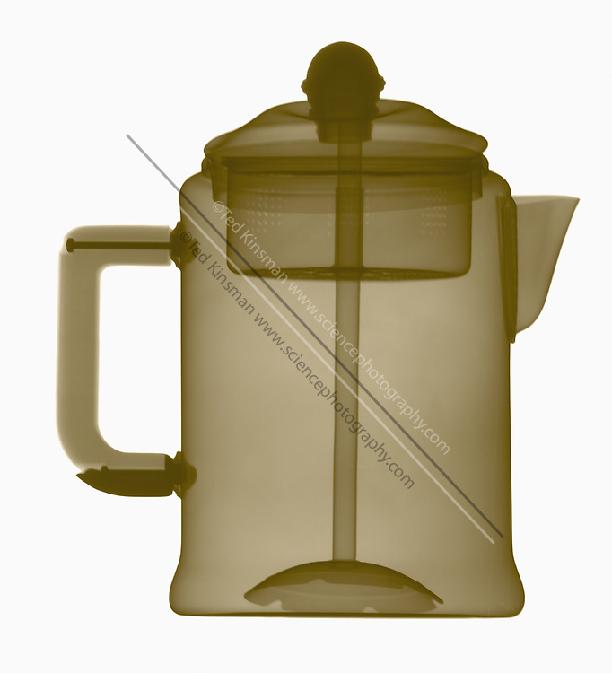 An x-ray shows the inner parts of a coffee pot percolator.   The coffee is placed in the top of the device and boiling water is forced up the central pipe to flow over the coffee.  Percolated coffee has an extremely high concentration of caffeine.