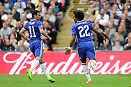 Chelsea's Willian (22) celebrates his and Chelsea's second goal with team mate Pedro (11) after he scores his teams 2nd goal from a penalty. The Emirates FA Cup semi-final match, Chelsea v Tottenham Hotspur at Wembley Stadium in London on Saturday 22nd April 2017.<br /> pic by Carl Robertson,  Andrew Orchard sports photography.