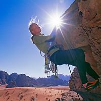 Lisa Gnade rock climbs in Rakabat Siq (canyon) on Jebel (Mount) Um Ishrin, Wadi Rum.