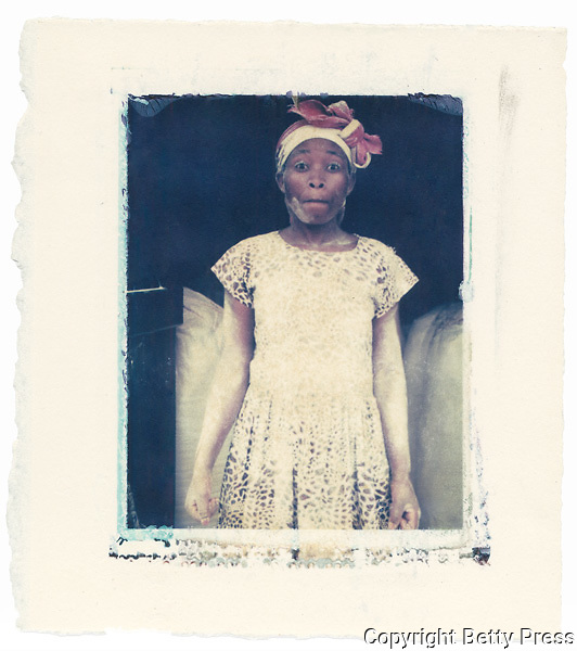 Woman working in a flour mill, Uganda<br /> Image size 4x5, Matted 12x10 Edition of 25 <br /> Archival Pigment Print