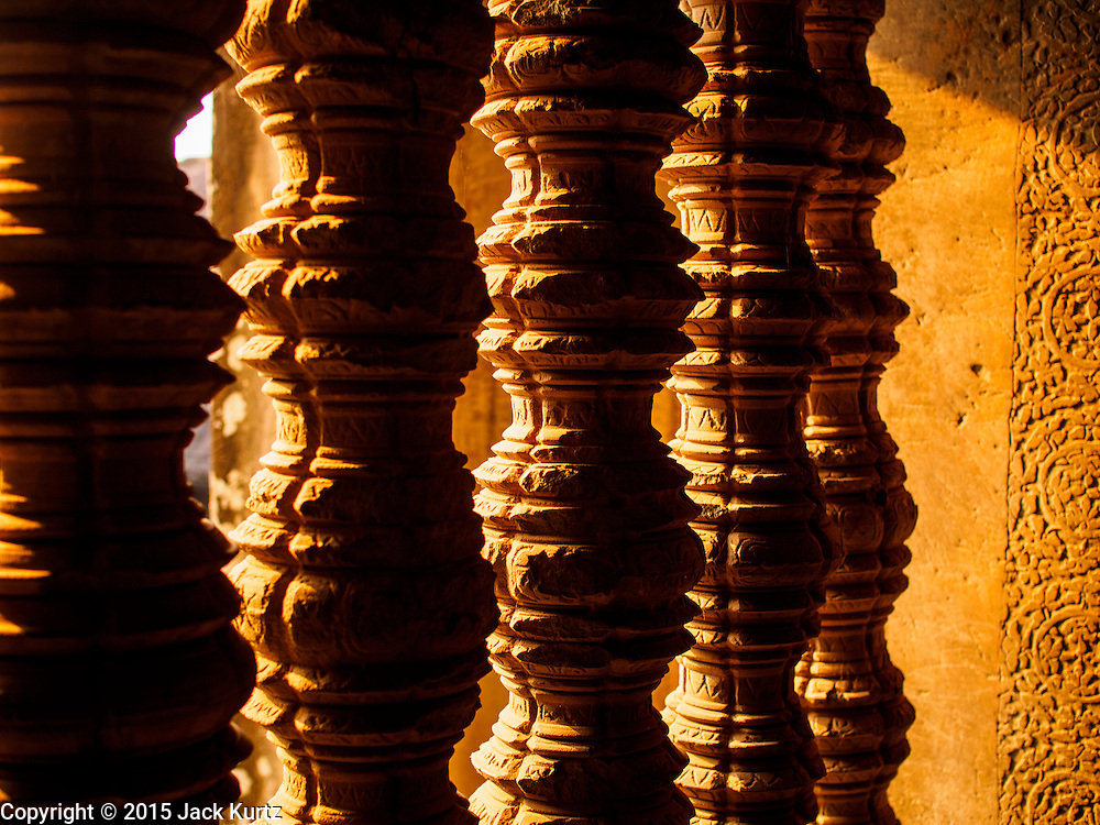 """13 MARCH 2015 - SIEM REAP, SIEM REAP, CAMBODIA:  Wooden bannisters in the Angkor Wat. The area known as """"Angkor Wat"""" is a sprawling collection of archeological ruins and temples. The area was developed by ancient Khmer (Cambodian) Kings starting as early as 1150 CE and renovated and expanded around 1180CE by Jayavarman VII. Angkor Wat is now considered the seventh wonder of the world and is Cambodia's most important tourist attraction.   PHOTO BY JACK KURTZ"""