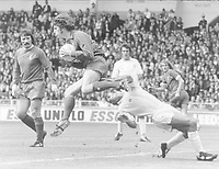 Football : Leeds United v Liverpool FA Charity Shield 10/08/1974 <br /> Ray Clemence - Liverpool beats Paul Reaney (Leeds) to the ball. Tommy Smith (left) Credit: Colorsport