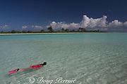 snorkeler explores lagoon in front of Paris Beach, Christmas Island ( Kiritimati ), Republic of Kiribati, northern Line Islands, equatorial Central Pacific Ocean, MR 299