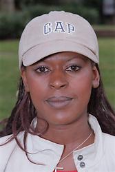 Portrait of young woman wearing baseball cap,