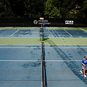 A worker uses a brush to move water from the court after a brief storm caused a rain delay during the ITF Head/First Federal Women's $10,000 pro tennis tournament at Van Der Meer Tennis Center off of Deallyon Avenue on May 31, 2014.