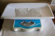 Baby weighing scales on the NICU (Neonatal Intensive Care Unit) Ward. St Walburg's Hospital, Nyangao. Lindi Region, Tanzania.