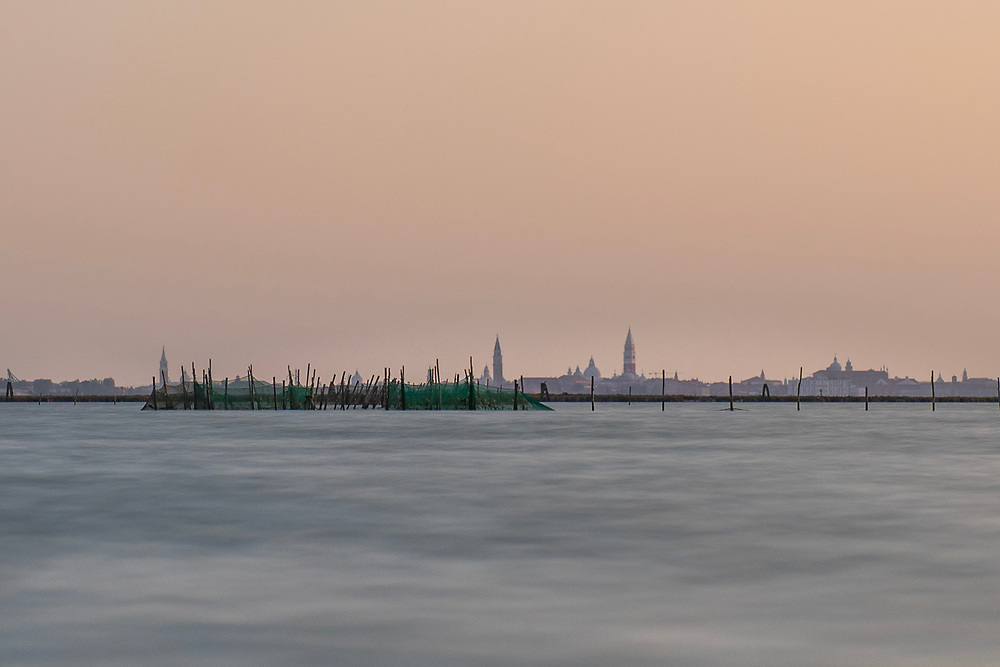 VENICE, ITALY - APRIL 2018. <br /> The places where to pose the fishing nets are chosen with a lottery every year. Of course there are areas that are good and areas that are not good. Everyone accept their fate, knowing that it will change every year. Sometimes it is close to the city of Venice, sometimes far away, out in the lagoon.