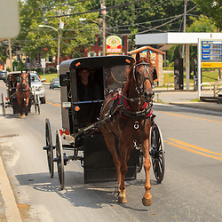 Intercourse, PA, USA - June 17, 2012: Amish horse-drawn buggies in Intercourse, PA.