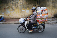 """Goldfish transport, Saigon, Vietnam<br /> Available as Fine Art Print in the following sizes:<br /> 08""""x12""""US$   100.00<br /> 10""""x15""""US$ 150.00<br /> 12""""x18""""US$ 200.00<br /> 16""""x24""""US$ 300.00<br /> 20""""x30""""US$ 500.00"""