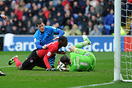 Nottingham Forest's Darius Henderson © has a shot saved by Cardiff keeper David Marshall.  Npower championship, Cardiff city v Nottingham Forest at the Cardiff city stadium in Cardiff, South Wales on Saturday 13th April 2013. pic by Andrew Orchard,  Andrew Orchard sports photography,