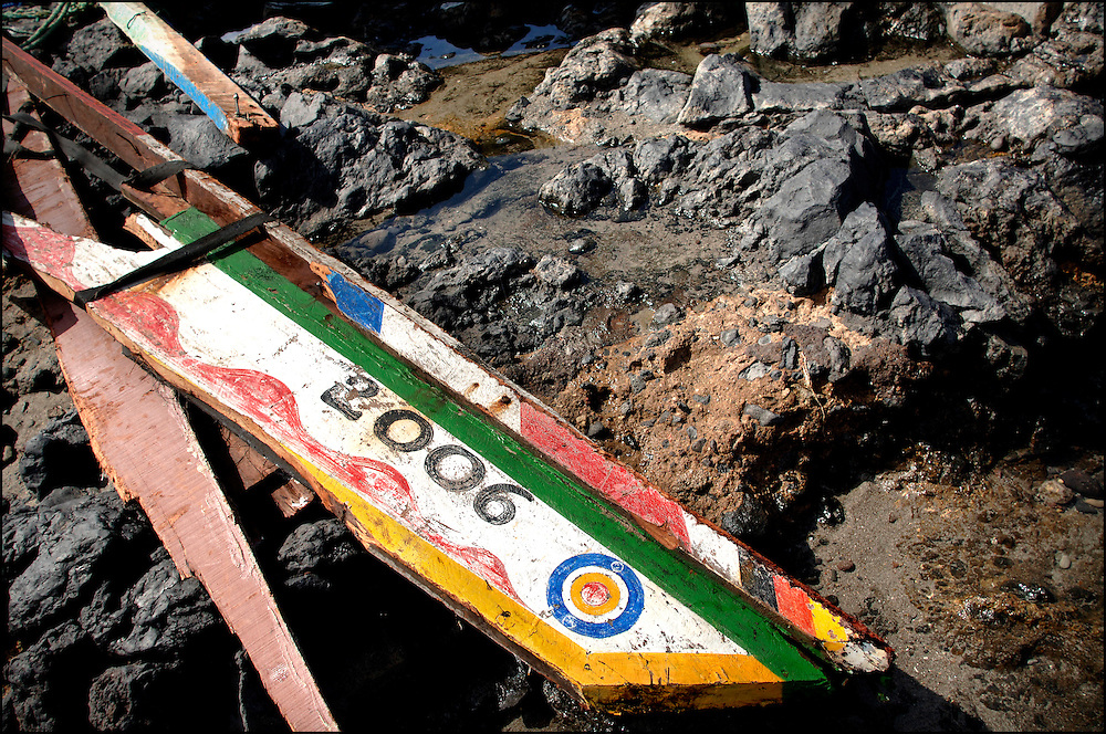 """Tenerife / Los Cristianos June 7, 2006 - A fishing boat called """"Cayucos"""" by the inhabitants of the island of Tenerife, is found on the beach after one night of storm. Spanish authorities say the Canary Islands has intercepted more than 7,000 imigrants since January"""