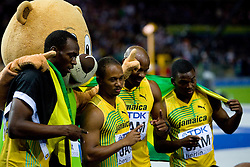 (L-R) Usain Bolt, mascot Berlino, Michael Frater, Asafa Powell and Steve Mullings celebrate winning the gold medal in the mens 4x100 Metres Relay Final with mascot Berlino during day eight of the 12th IAAF World Athletics Championships at the Olympic Stadium on August 22, 2009 in Berlin, Germany. (Photo by Vid Ponikvar / Sportida)