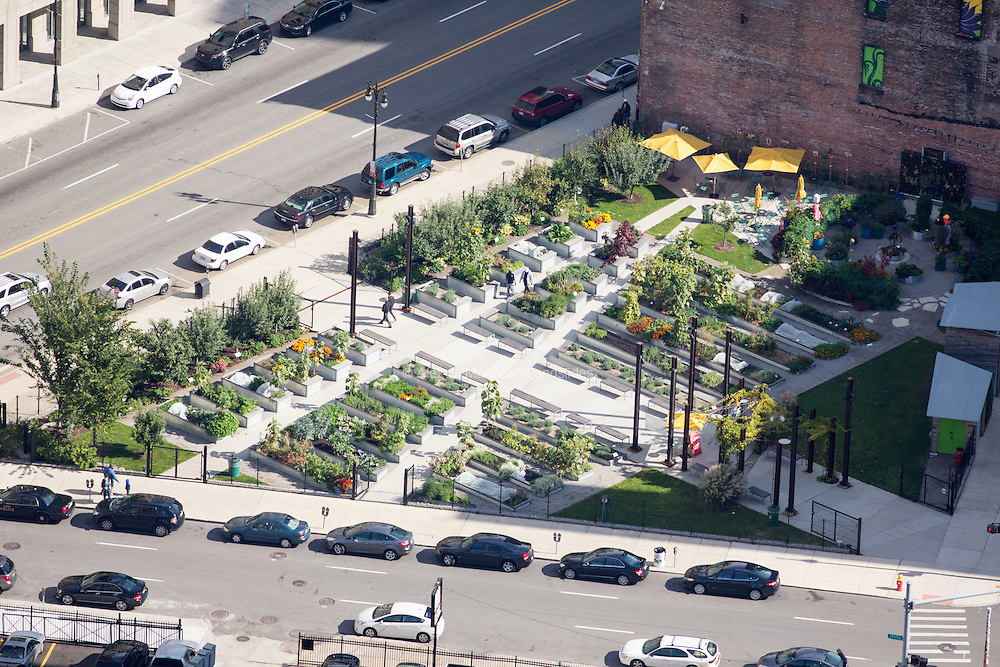 Urban garden designed by Kenneth Weikal Landscape Architecture in Farmington Hills, MI. This .425 acre garden fills a parcel of city land left vacant after the 2010 demolition of the historic Lafayette Building in downtown Detroit.
