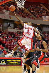 """08 December 2007: Keith """"Boo"""" Richardson drives the line, bearcats in tow, for a lay up. The Cincinnati Bearcats take a loose against the Illinois State Redbirds 62-52 on Doug Collins Court in Redbird Arena on the campus of Illinois State University in Normal Illinois."""