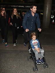 Christian Bale and Sibi Blazic are seen at LAX Airport in Los Angeles