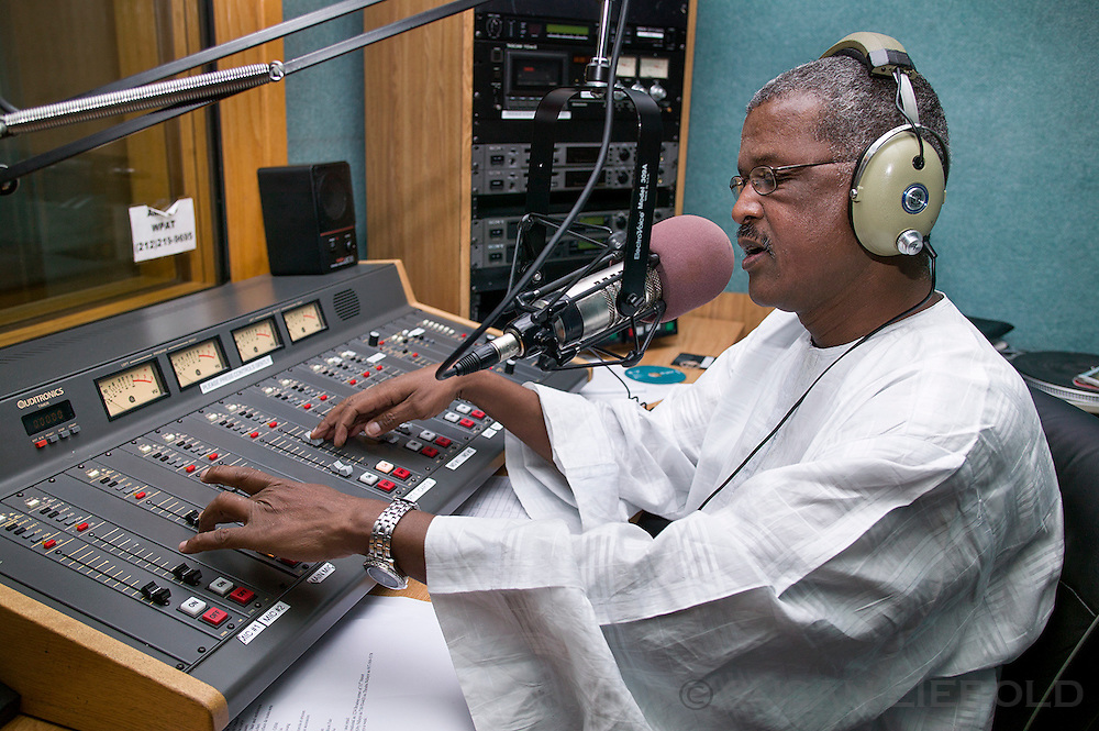 Dame on air with the late night Senegalese radio program in lower Manhattan.
