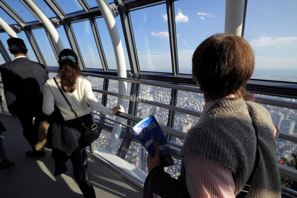 Skytree Tower people looking out over Tokyo from Tembo Galleria at floor 445-450