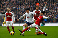 Hector Bellerin of Arsenal (L) tackles Son Heung-min of Tottenham Hotspur (R).  Premier league match, Tottenham Hotspur v Arsenal at Wembley Stadium in London on Saturday 10th February 2018.<br /> pic by Steffan Bowen, Andrew Orchard sports photography.