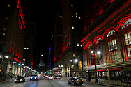 Buildings on the Avenue of the Arts are lit by red light Sept. 1, 2020, in Philadelphia, Pennsylvania, signifying the 'Red Alert' workers in the live events industry are facing due to the impact of the COVID-19 pandemic. This nationwide effort, organized by the Live Events Coalition, is also a push for Congress towards continuation and extension of the Pandemic Unemployment Assistance to provide relief to those without work due to COVID-19.