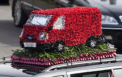 © Licensed to London News Pictures. 03/05/2018. St Mary Cray, UK. RED VAN FLOWERS ON A CAR ROOF. The funeral of burglar Henry Vincent in St Mary Cray, Bromley, London. Henry Vincent, who is part of a traveller community in the south east London, died during an attempted burglary of the home of pensioner Richard Osborn-Brook in Hither Green. Photo credit: Ben Cawthra/LNP