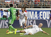 JACKSONVILLE, FL - JUNE 07:  Midfielder Michael Bradley #4 of the United States slides to break up a pass to midfielder Ogenyi Onazi #17 of Nigeria during the international friendly match at EverBank Field on June 7, 2014 in Jacksonville, Florida.  (Photo by Mike Zarrilli/Getty Images)