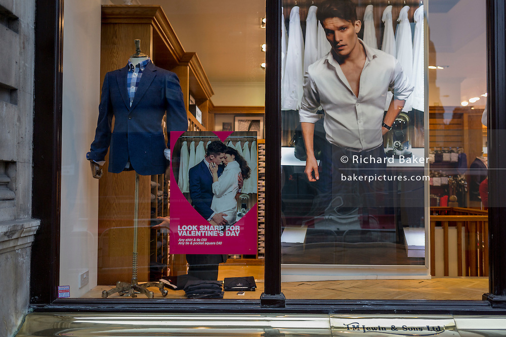 A Valentines Day poster in the window of TM Lewin, a City menswear retailer, on 9th February 2017, in the City of London, England.