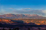 Eleven thousand feet above sea level, the Abajo mountains rise above Texas canyon with the shadow of the Bear's Ears in the foreground.