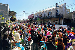 09 February 2016. New Orleans, Louisiana.<br /> Mardi Gras Day. Revelers in bright and coolurful costumes fill the French Quarter. <br /> Photo©; Charlie Varley/varleypix.com