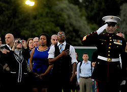 A member of the public pays his respects during the National Anthem - Photo mandatory by-line: Joe Meredith/JMP - Mobile: 07966 386802 - 9/09/14 - Winfield reception for the Invictus Games - London - Winfield House