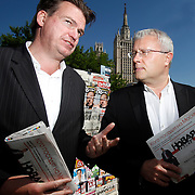 Russian oligarch Alexander Lebedev chats with Spiegel correspondent Matthias Schepp with a copy of the newspaper Novaya Gazeta by a newstand in Moscow. Lebedev is a part-owner of the independent news publication, which employs some of Russia's most courageous journalists including slain reporter Anna Politkovskaya. Lebedev also owns London's Evening Standard newspaper.