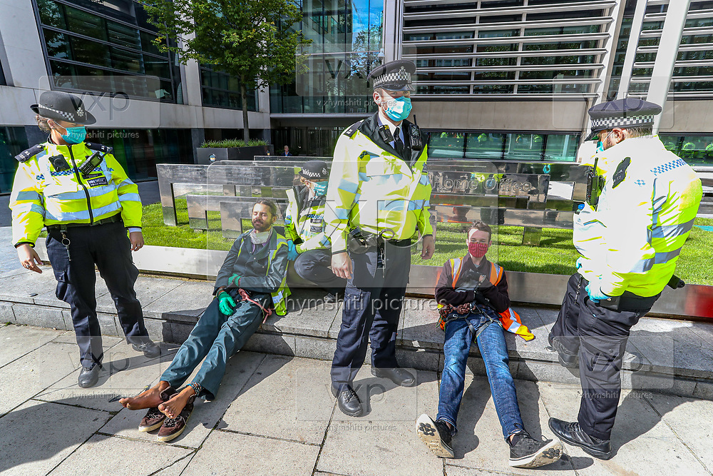 Two Extinction Rebellion climbers who tried to occupy the trees outside Home Office in Marsham Street in London are arrested and handcuffed by the Police on Friday, Sept 4, 2020. <br /> Marsham street remains both ways closed by the police. There are other Extinction Rebellion protests ongoing in London. Environmental nonviolent activists group Extinction Rebellion enters its 4th day of continuous ten days protests to disrupt political institutions throughout peaceful actions swarming central London into a standoff, demanding that central government obeys and delivers Climate Emergency bill. (VXP Photo/ Vudi Xhymshiti) Extinction Rebellion climber who tried to occupy one of the trees outside Home Office in Marsham Street in London is arrested and handcuffed by the Police on Friday, Sept 4, 2020. <br /> Marsham street remains both ways closed by the police. There are other Extinction Rebellion protests ongoing in London. Environmental nonviolent activists group Extinction Rebellion enters its 4th day of continuous ten days protests to disrupt political institutions throughout peaceful actions swarming central London into a standoff, demanding that central government obeys and delivers Climate Emergency bill. (VXP Photo/ Vudi Xhymshiti)