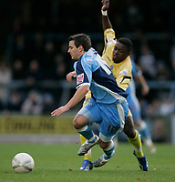 Photo: Marc Atkins.<br />Wycombe Wanderers v Oxford United. The FA Cup. 11/11/2006. Matt Bloomfield of Wycombe is felled by Yemi Odubade of Oxford.