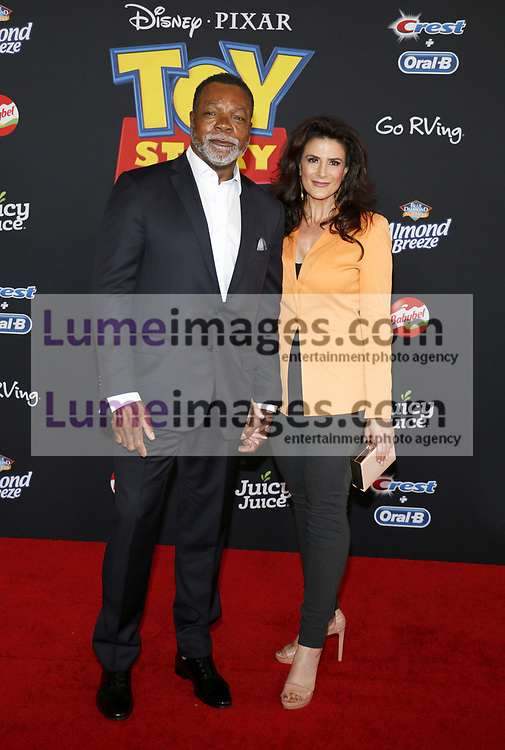 Carl Weathers and Christine Kludjian at the World premiere of 'Toy Story 4' held at the El Capitan Theater in Hollywood, USA on June 11, 2019.