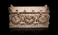 """Picture of Roman relief sculpted Sarcophagus of Garlands, 2nd century AD, Perge. This type of sarcophagus is described as a """"Pamphylia Type Sarcophagus"""". It is known that these sarcophagi garlanded tombs originated in Perge and manufactured in the sculptural workshops of Perge. Antalya Archaeology Museum, Turkey. Against a black background.<br /> <br /> If you prefer to buy from our ALAMY STOCK LIBRARY page at https://www.alamy.com/portfolio/paul-williams-funkystock/greco-roman-sculptures.html . Type -    Antalya    - into LOWER SEARCH WITHIN GALLERY box - Refine search by adding a subject, place, background colour, etc.<br /> <br /> Visit our ROMAN WORLD PHOTO COLLECTIONS for more photos to download or buy as wall art prints https://funkystock.photoshelter.com/gallery-collection/The-Romans-Art-Artefacts-Antiquities-Historic-Sites-Pictures-Images/C0000r2uLJJo9_s0"""