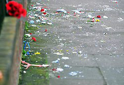 © Licensed to London News Pictures.11/04/2018<br /> HITHER GREEN, UK.<br /> AN EMPTY LOOKING SHRINE IN Hither Green this evening (6.30pm) with one bunch of red flowers from a member of the public place on the wall with a mess of flower petals on the ground.<br />  Hither Green Burglary Murder. South Park Crescent,Hither Green.<br />  Home of 78 year old Richard Osborn-Brooks who stabbed a burglar to death in his home.<br /> Photo credit: Grant Falvey/LNP
